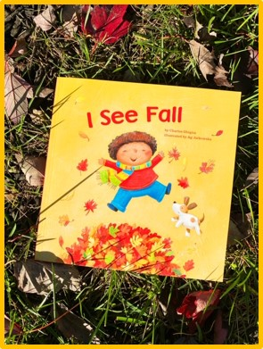 "The first of my five fall read alouds is shown. The cover of the book ""I See Fall"" is shown. The cover of the book shows a boy jumping in the leaves. The book is laying on the grass with leaves surrounding it."