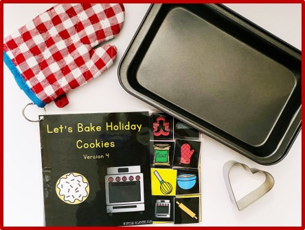 """In the image, an adapted book titled """"Let's Bake Holiday Cookies"""" is shown. Surrounding the book are baking materials: a red checkered oven mitt, a grey baking sheets, and a heart cookie cutter."""