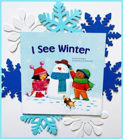 """This image shows the front of the book """"I See Winter."""" Behind the picture book are white and blue foam snowflakes."""