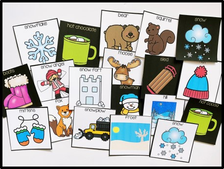 Winter themed vocabulary cards are pictured. The vocabulary cards are shown with both a black and white background.