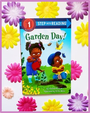 "A cover of a spring read aloud book: ""Garden Day"" by Candice Ransom is shown with bright colored flowers in the background."