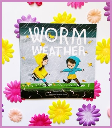 The cover of a spring read aloud book: Worm Weather by Jean Taft is shown with a background of bright colored flowers.