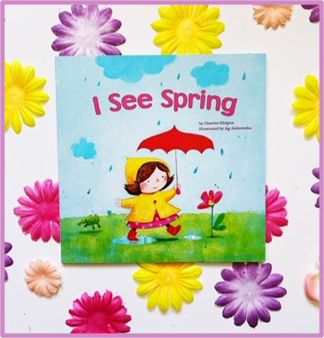 "The cover of ""I See Spring"" by Charles Ghinga is shown on top of bright colored flowers."
