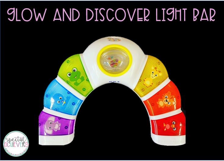 """The text at the top of the image says """"Glow and Discover Light Bar."""" An image of this toy is shown below. The toy is a rainbow shape, that has light up sections that are the following colors from left to right: purple, blue, green, yellow, orange, and red."""